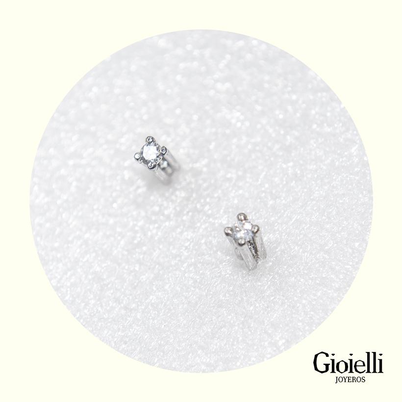 topos en oro blanco con diamante